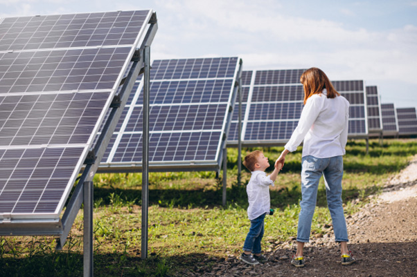 Mother and child walking around solar panels